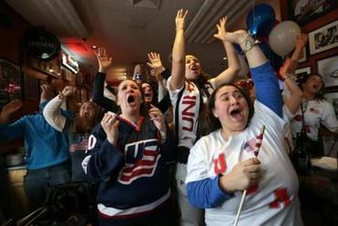 US fans reacted to third-period action on TVs showing the game between the US and Canadian women's teams in Sochi. In left foreground is Katie Duggan, sister of a player.